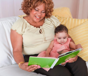 Woman reading to an infant