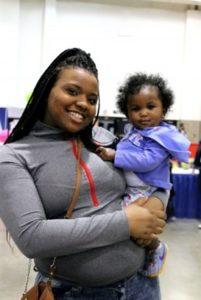 child care provider holding infant